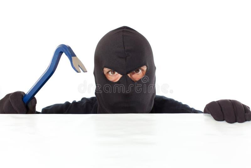 Ladrão com uma barra fotografia de stock