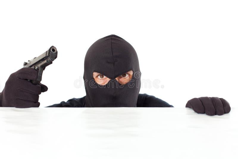 Ladrão com uma pistola foto de stock royalty free