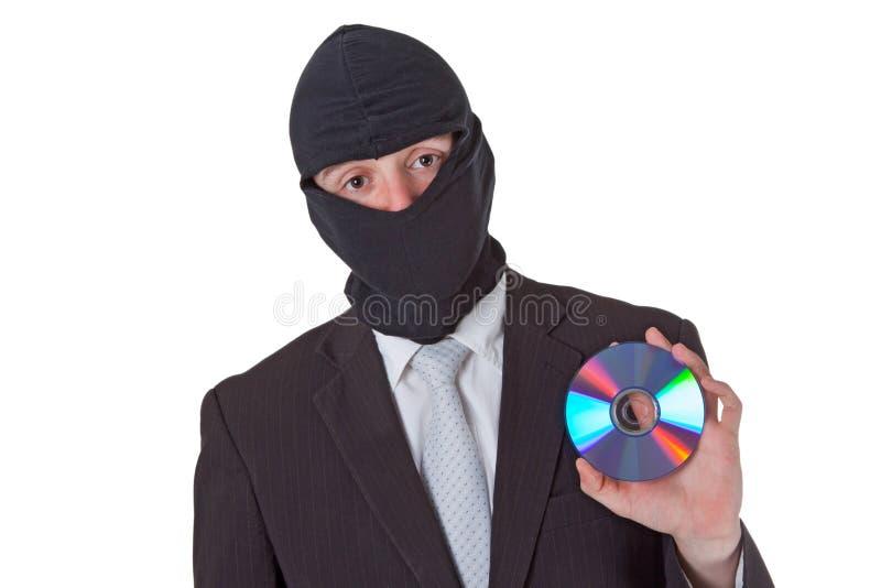 Ladrão que prende um disco dos dados fotos de stock
