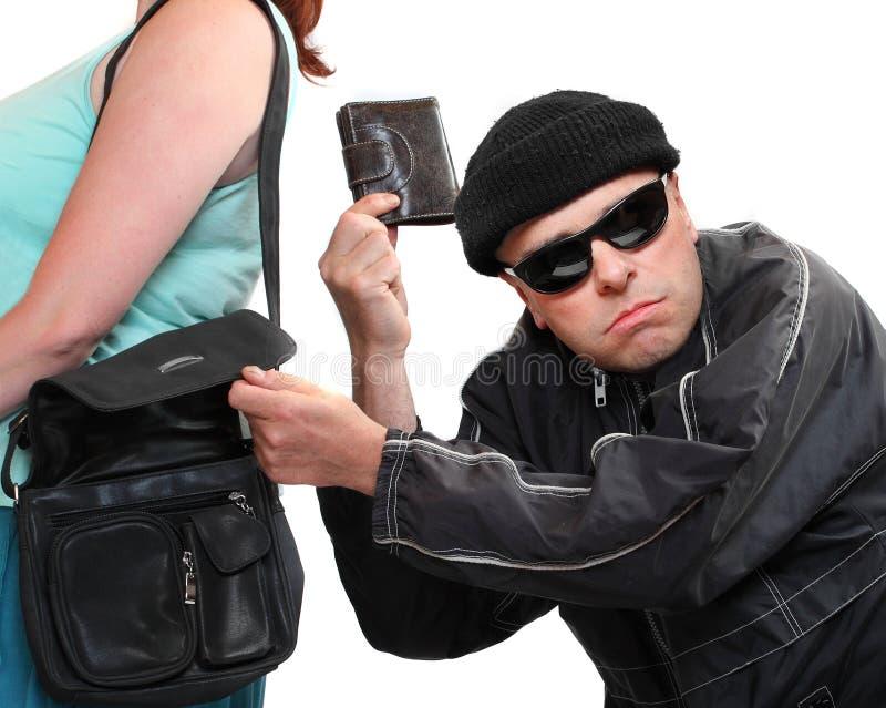 Ladrão que rouba da bolsa. imagens de stock
