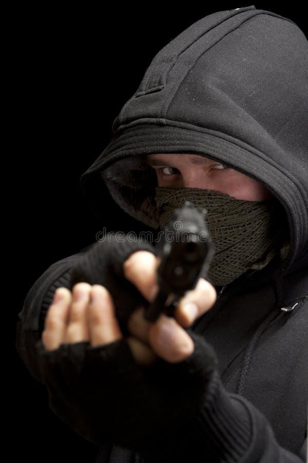 Ladrón con el arma fotografía de archivo libre de regalías