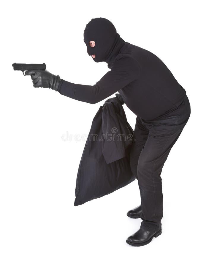 Ladrón con el arma foto de archivo libre de regalías