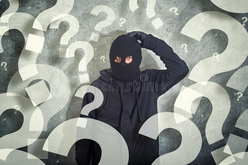 Ladrón confuso con la porción de preguntas imagen de archivo