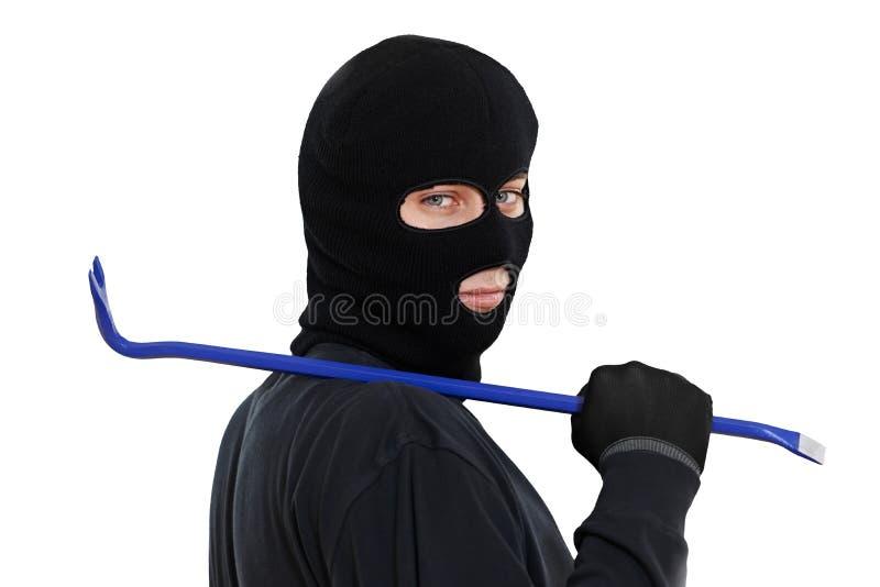 Ladrón del ladrón con la palanca del metal imagen de archivo