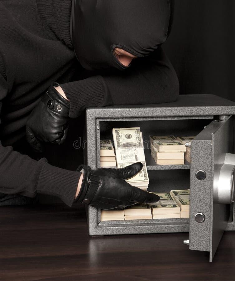 Ladrón del ladrón y caja fuerte del hogar imagen de archivo