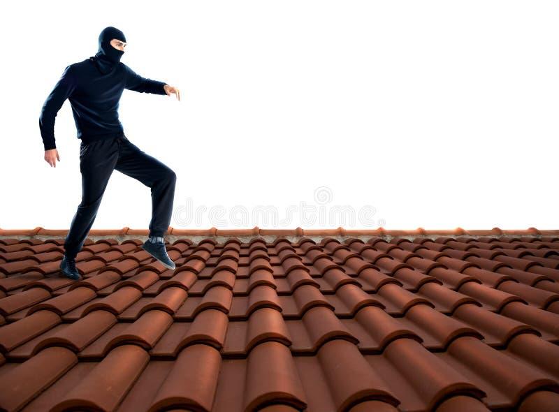Ladrón en el tejado foto de archivo