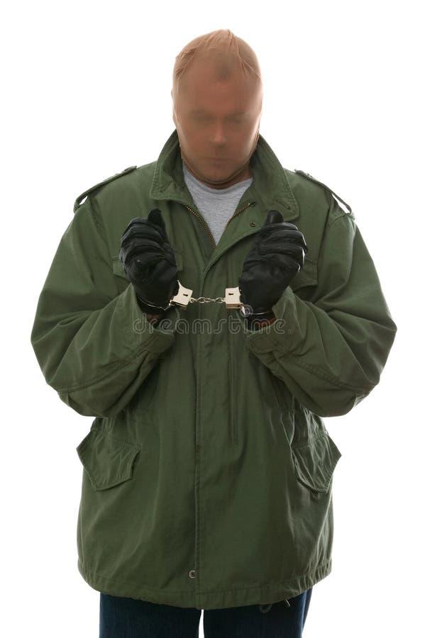 Ladrón en manillas foto de archivo libre de regalías