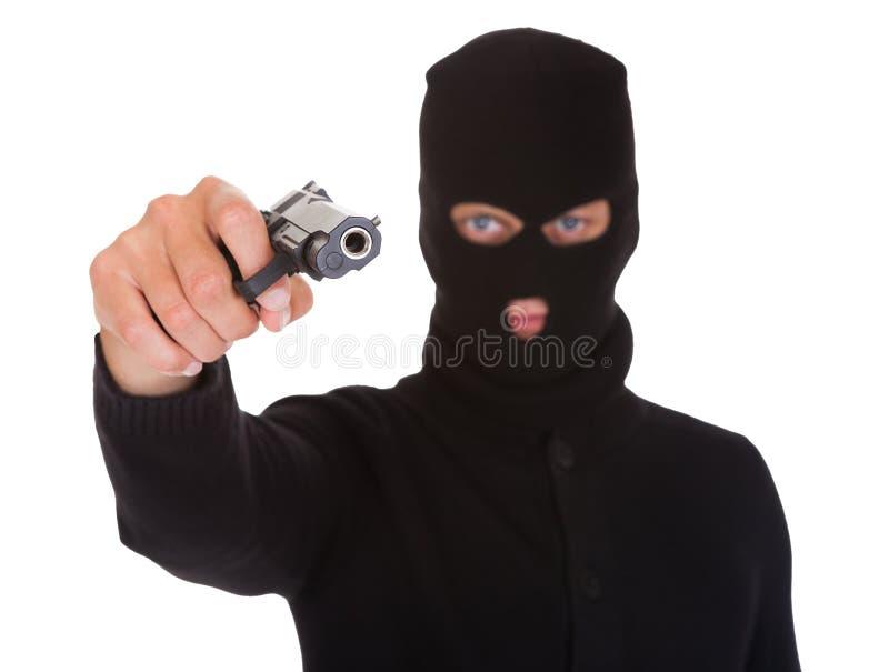 Ladrón Holding Hand Gun imágenes de archivo libres de regalías