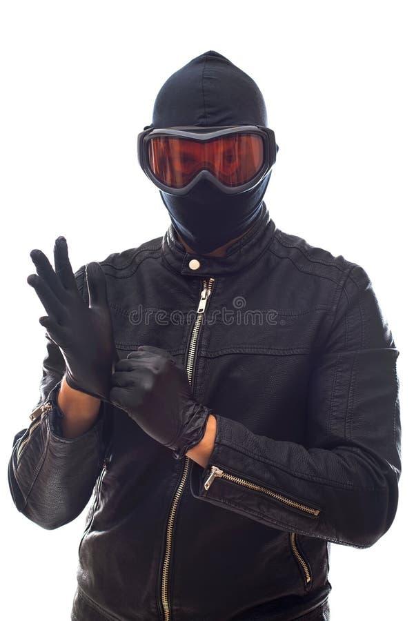 Ladrón peligroso en negro fotos de archivo