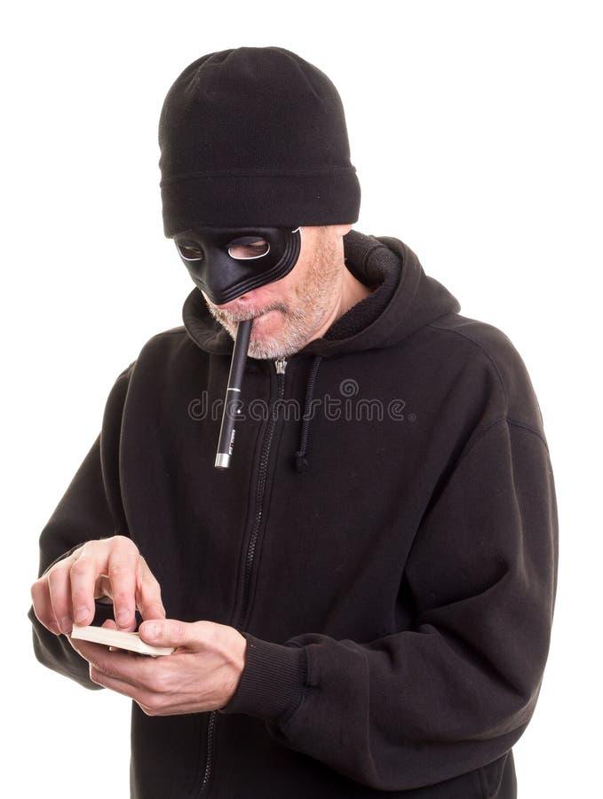 Ladrón que cuenta el dinero fotos de archivo