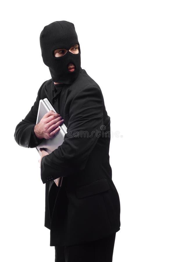 Ladrón que mira sobre hombro imagen de archivo libre de regalías