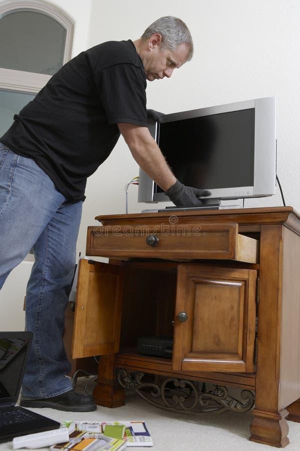 Ladrón Stealing Television fotografía de archivo