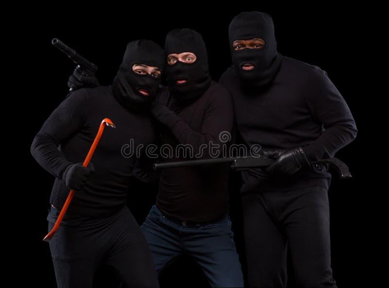 Ladri nelle maschere fotografia stock libera da diritti
