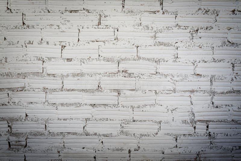 Ladrillo blanco con el fondo del cemento foto de archivo libre de regalías