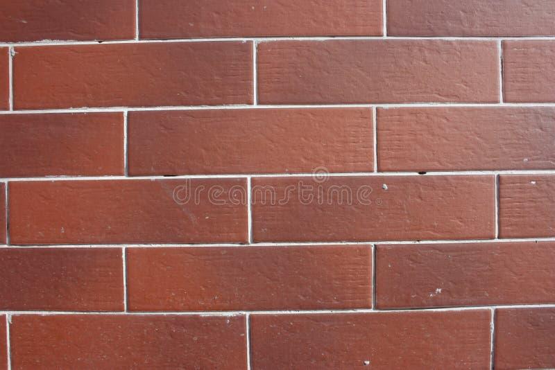 ladrillo El fondo es rojo foto de archivo libre de regalías