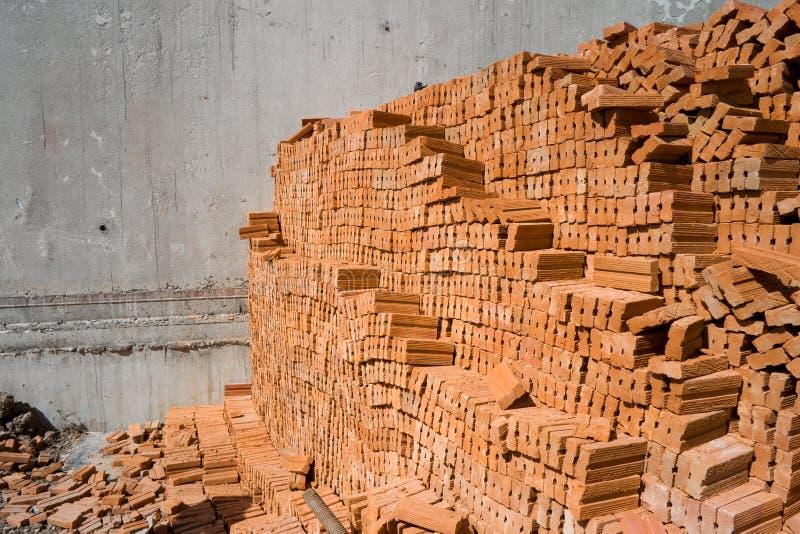Ladrillos anaranjados para el fondo de la construcción fotografía de archivo