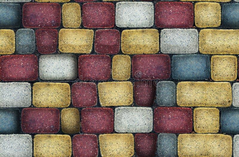 Ladrillos con clase del color stock de ilustración