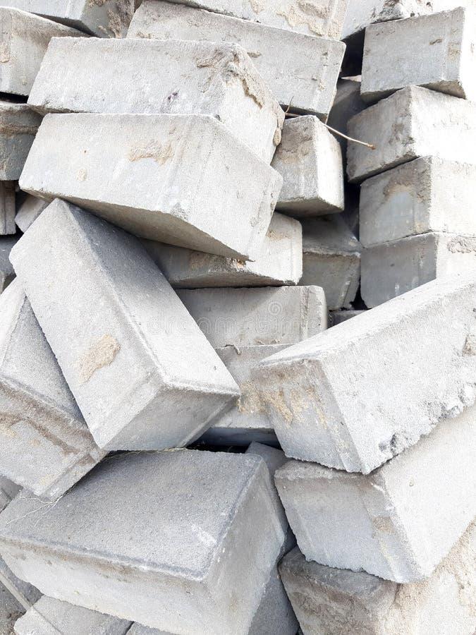 Ladrillos del fondo Materiales de construcci?n Montón de la foto Textura del gris, piedra fotografía de archivo libre de regalías