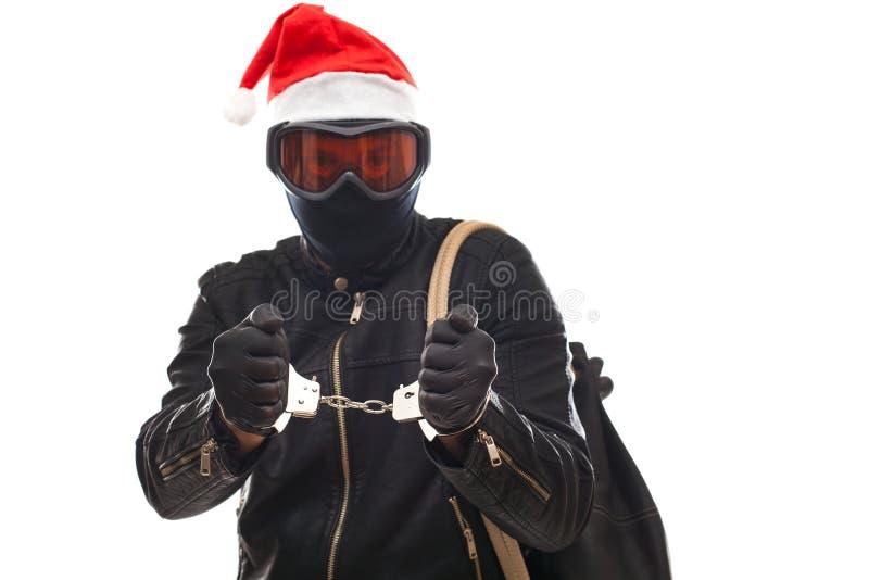 Ladro arrestato con il cappuccio del Babbo Natale immagine stock libera da diritti