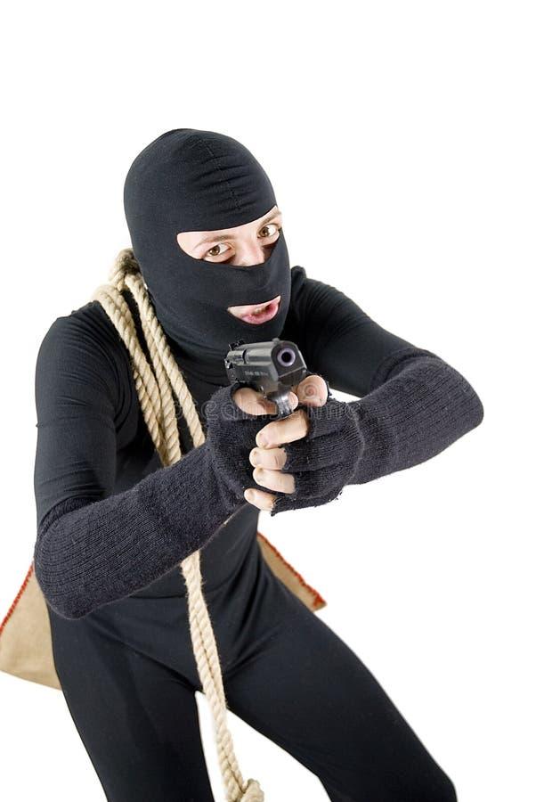 Ladro attento pronto a sparare fotografie stock libere da diritti
