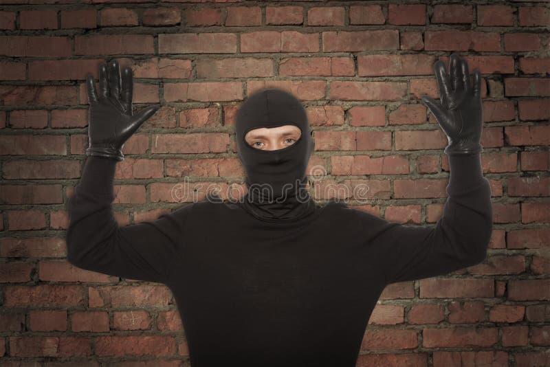 Ladro con la passamontagna fotografie stock