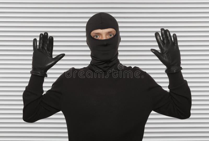 Ladro con la passamontagna immagini stock