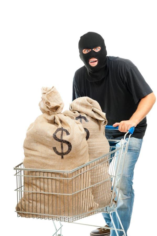 Ladro felice con il sacco pieno dei dollari fotografia stock