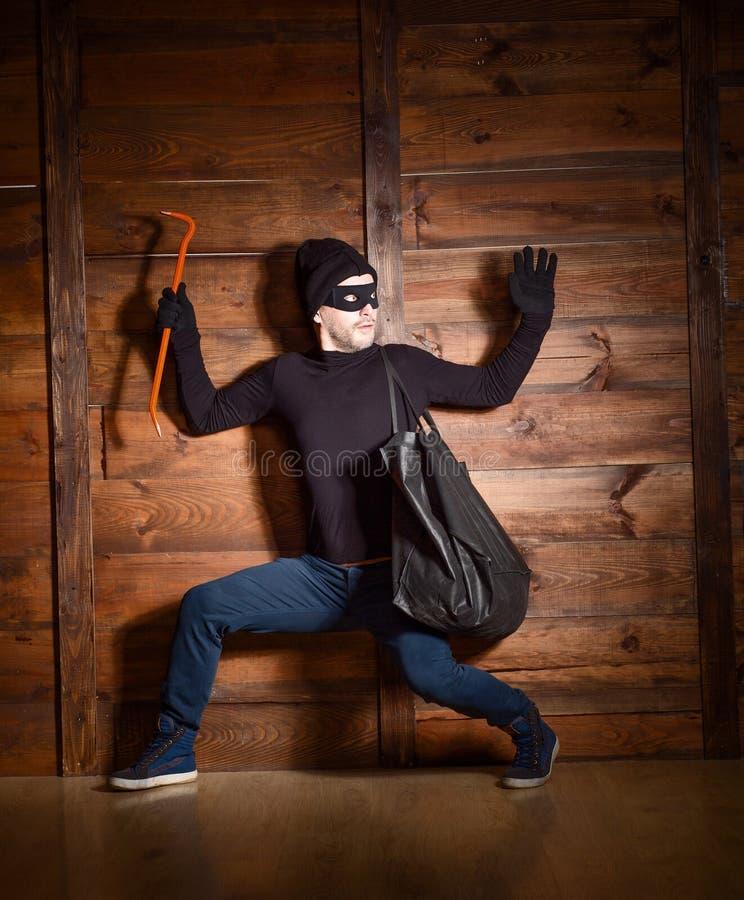 Ladro mascherato fotografia stock
