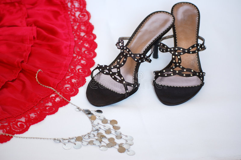 Lady accessories. Elegant lady shoe with attractive red skirt and bijouterie royalty free stock images