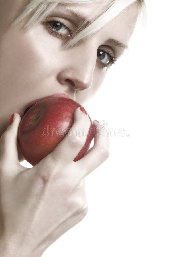 Lady and apple. A marvelous lady looking at you and eating an apple royalty free stock photography
