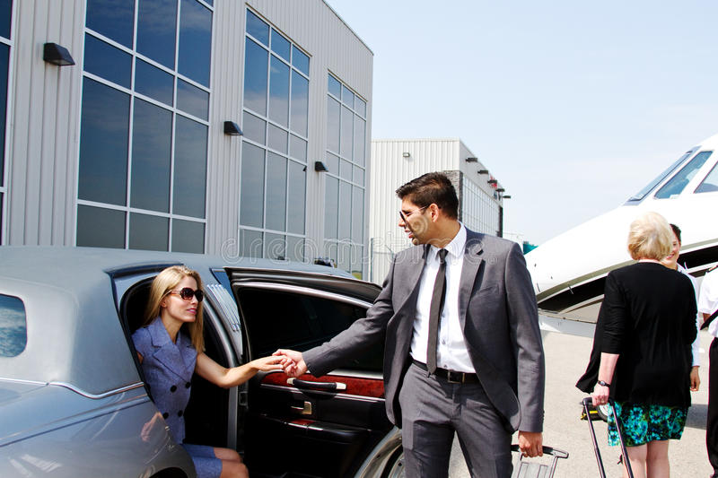 Lady arrives at private jet. Lady arrives in limo for travel in private jet royalty free stock photography