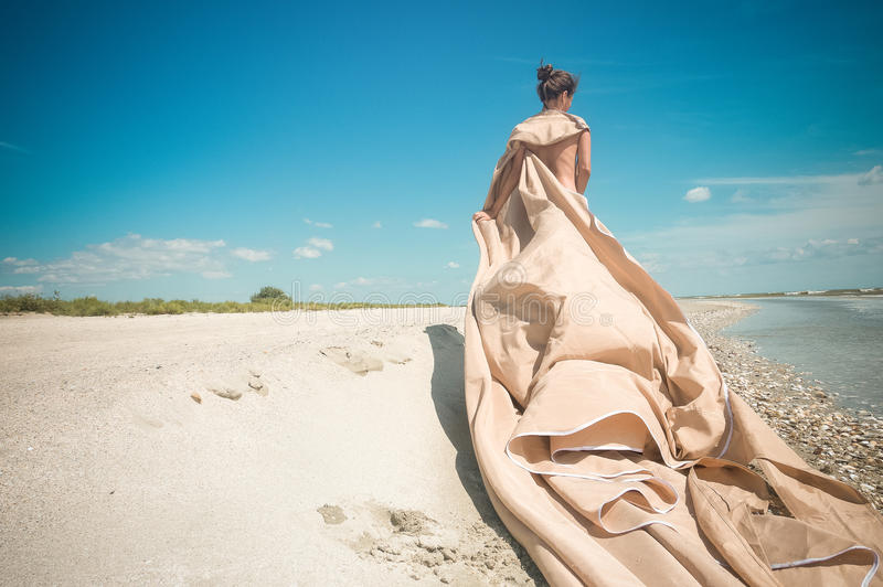 Lady at the beach stock photography