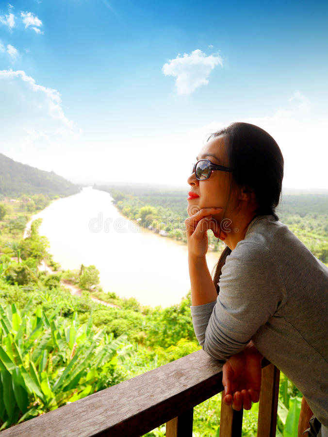 Lady with beautiful view of Suratthani, Thailand. Lady with beautiful river and mountain view of Phunphin, Suratthani, Thailand royalty free stock photography