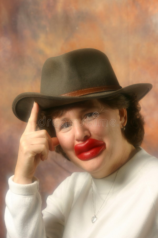Lady with big lips in cowboy hat royalty free stock photography