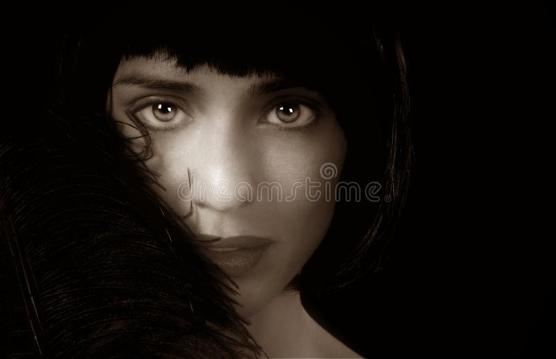 Lady With Black Feather royalty free stock photography