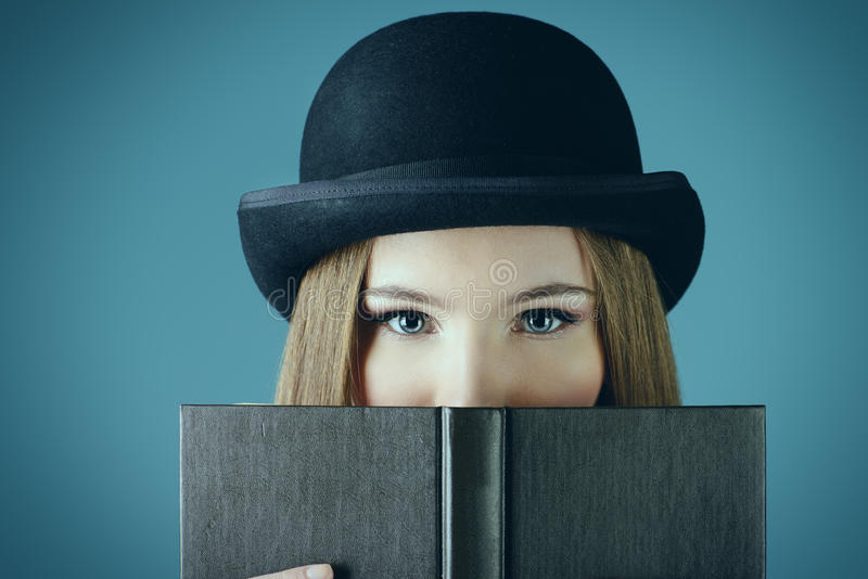 Lady and a book stock photo