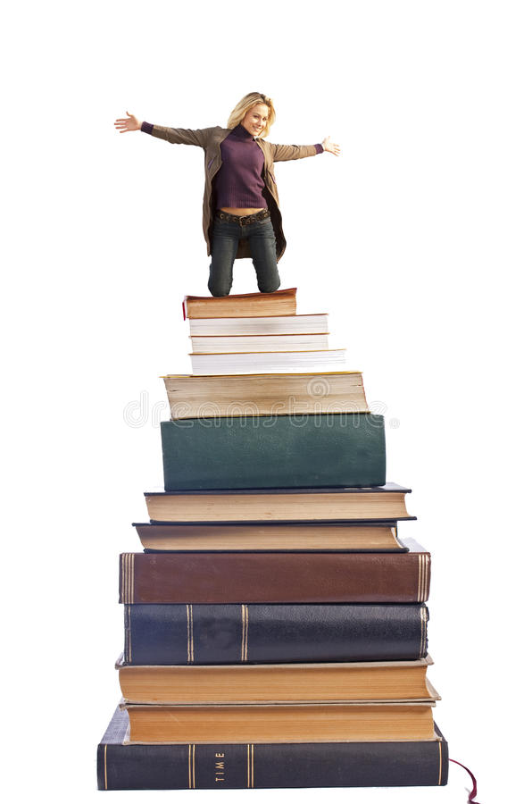 Lady on the books. A blond lady opens her arms on a pile of books. Isolated on white background