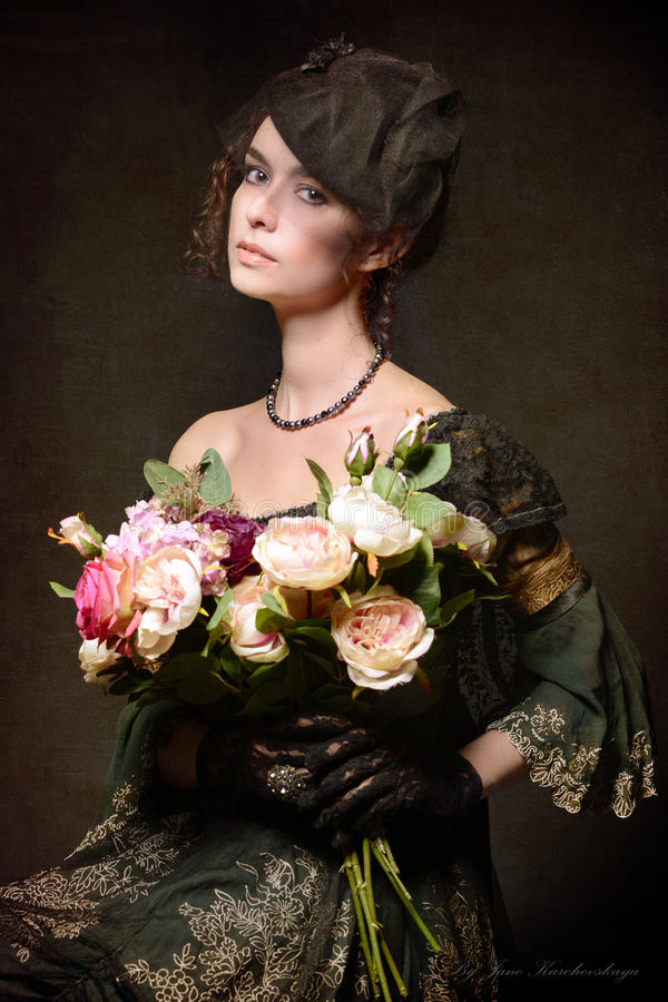 Lady with bouquet royalty free stock photography