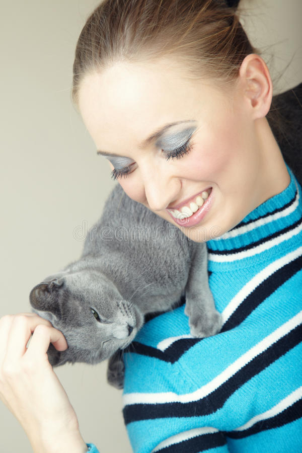 Lady And Cat Royalty Free Stock Photo