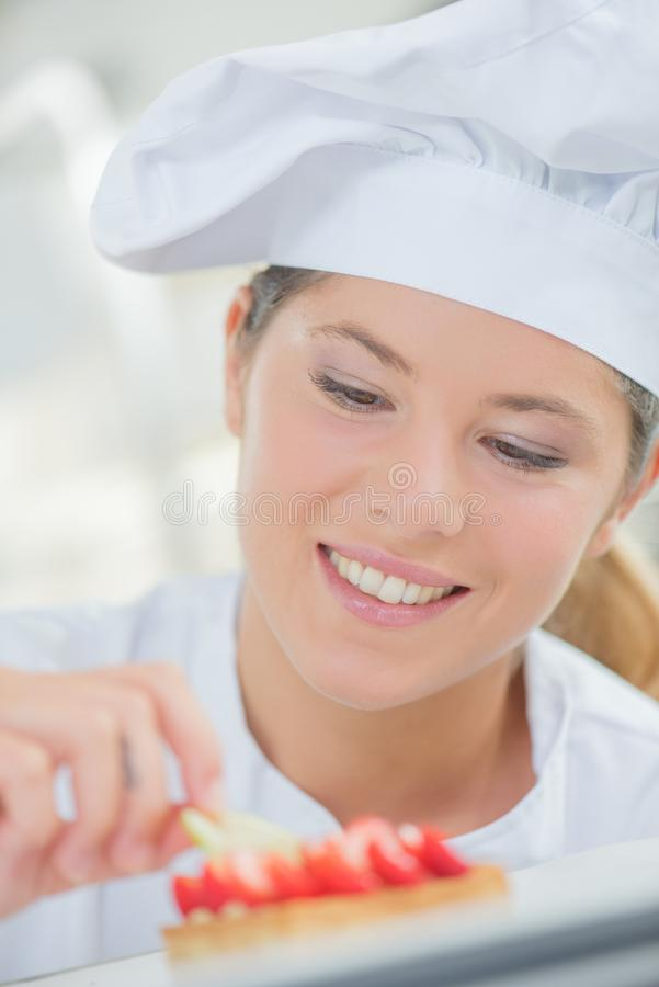 Lady chef at work stock photo