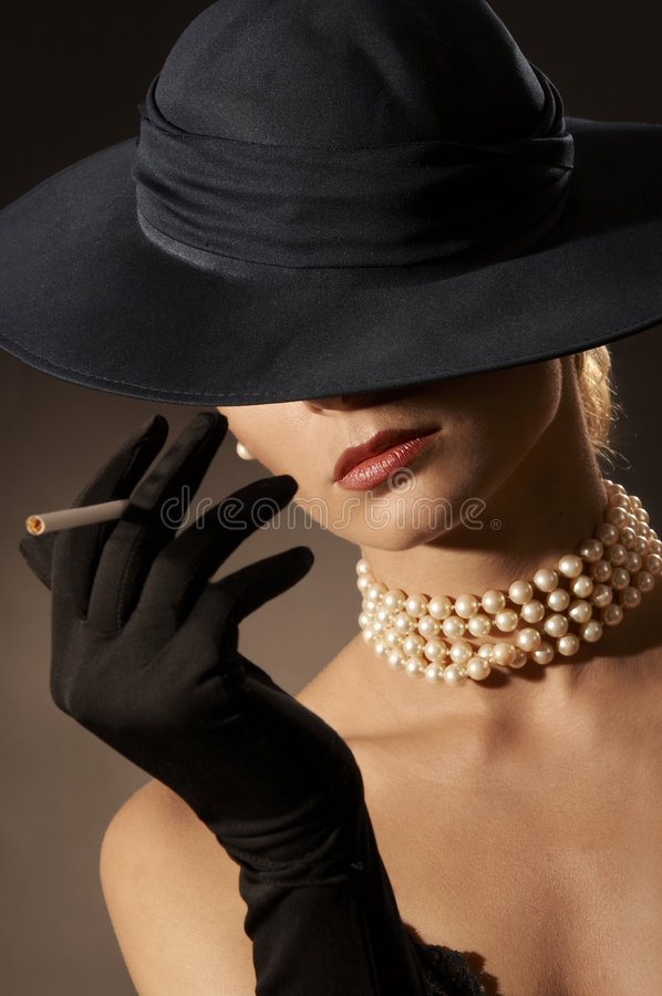 Lady And Cigarette Stock Photography