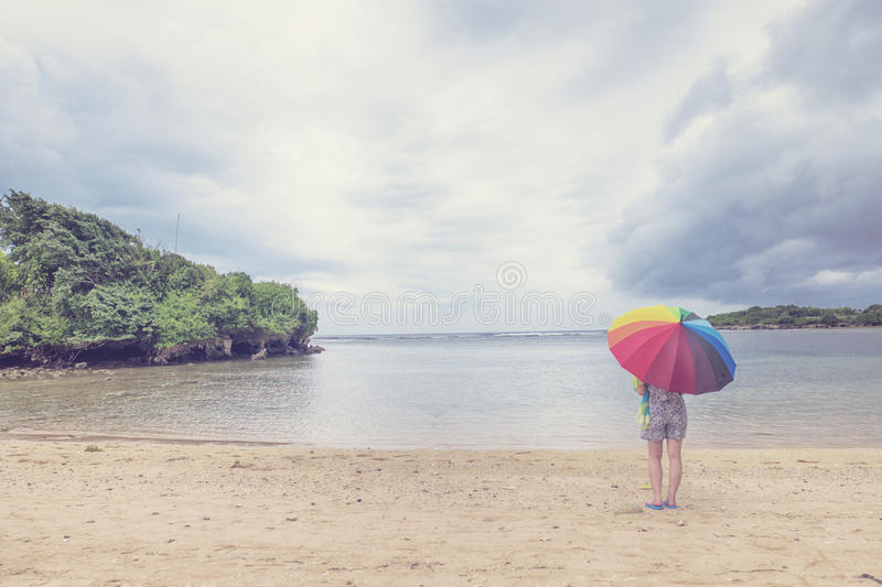 A lady and colorful umbrella stock image