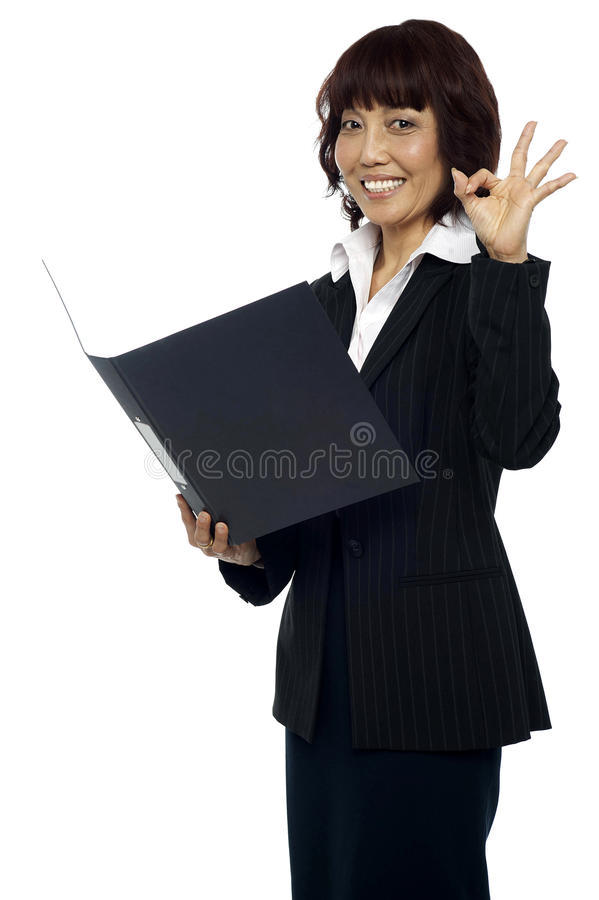 Download Lady Consultant Satisfied With The Report Stock Photo - Image: 26509866