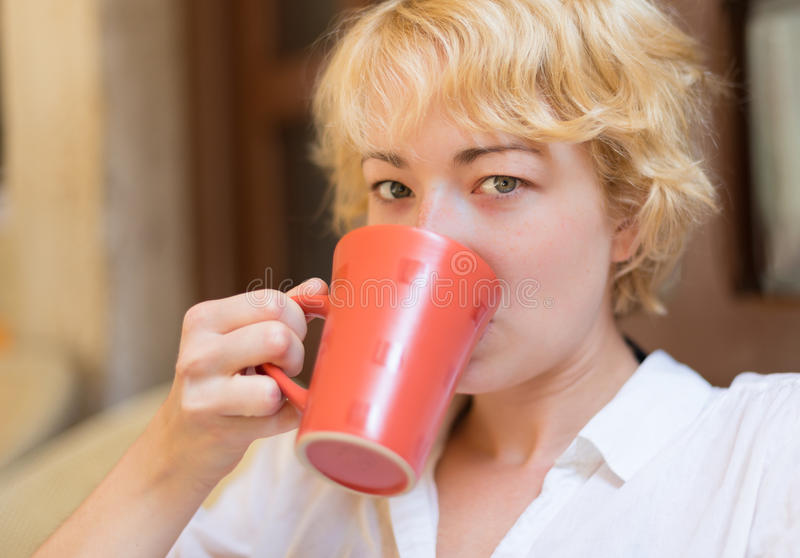 Lady With Cup of Coffee. royalty free stock photography