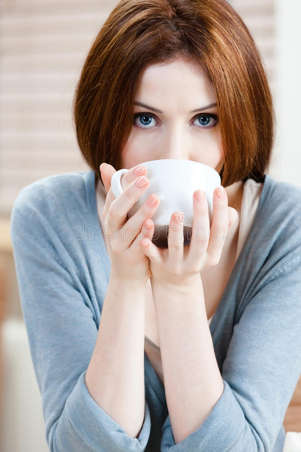 Download Lady with cup of tea stock image. Image of attractive - 27001383