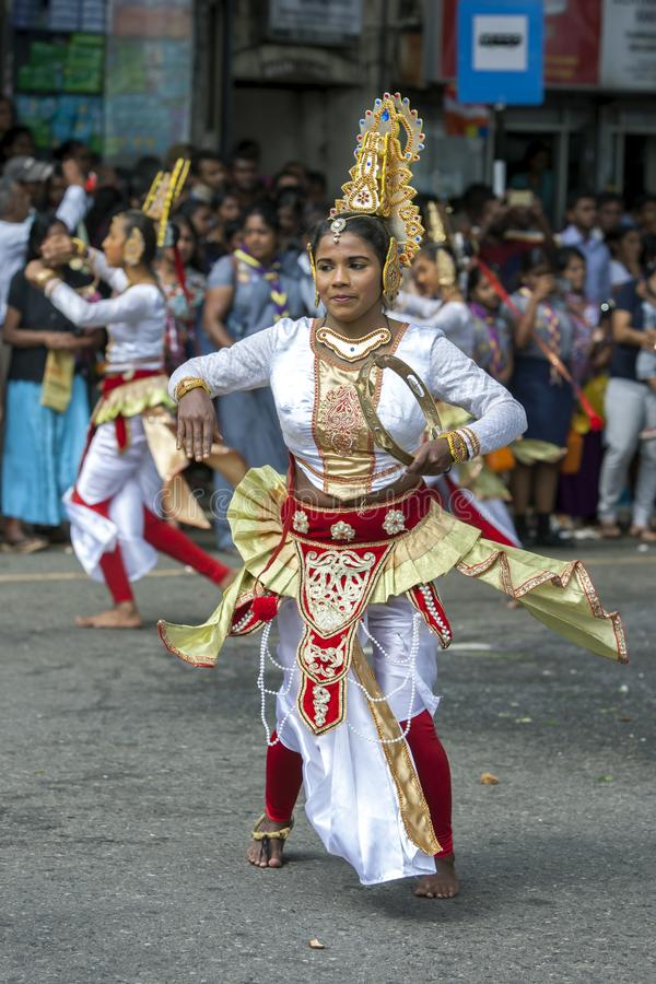 A lady dancing during the Day Perahera. stock images
