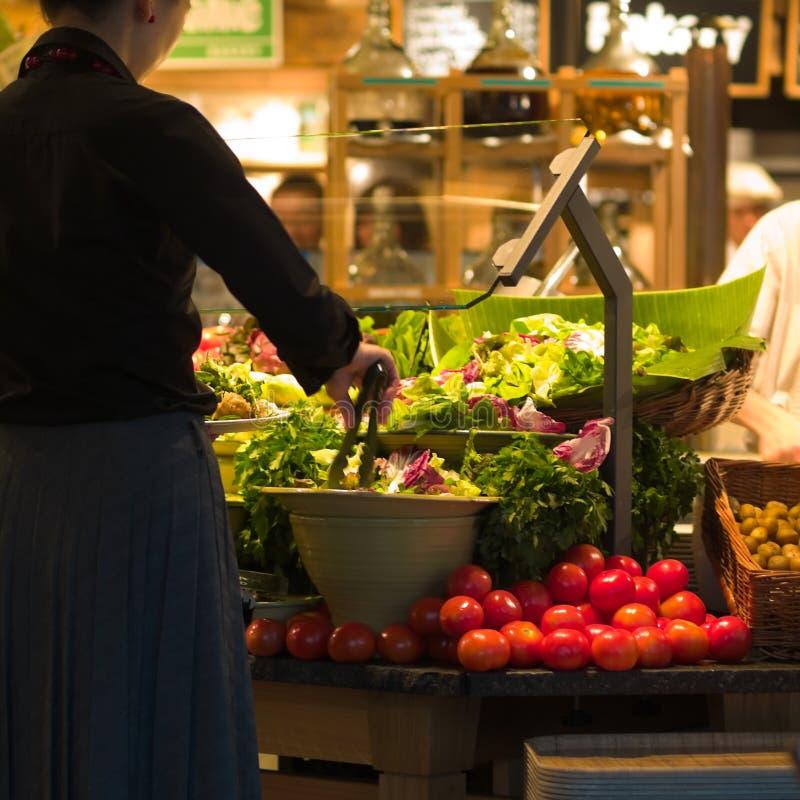 Lady Diner at Salad Bar stock images