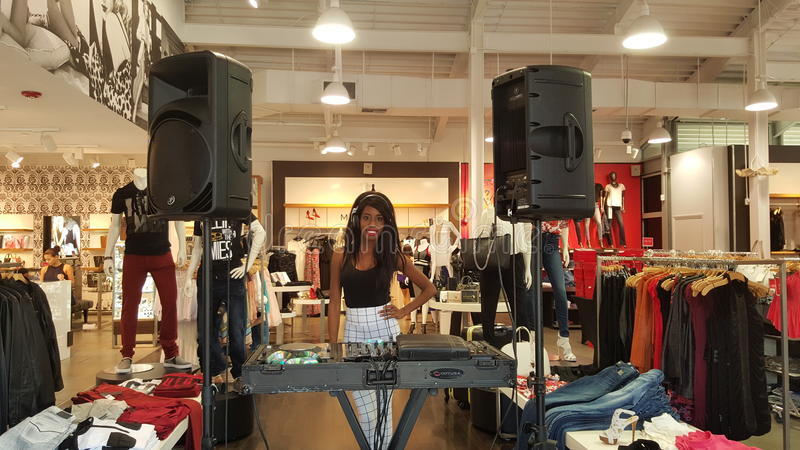 La Trice Perry. DJ La Trice Perry in a clothing store in Miami. Located in a Miami store spinning and playing great beats.-La Trice Perry is a model and stock images