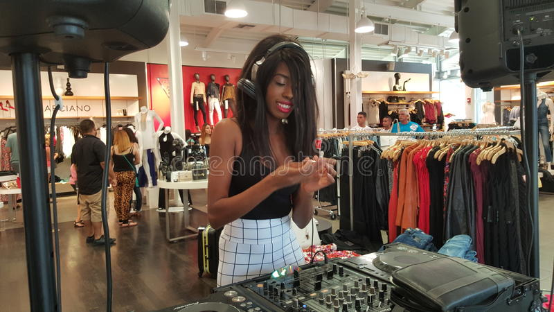 La Trice Perry. DJ La Trice Perry in a clothing store. Located in a Miami store spinning and playing great beats.-La Trice Perry is a model and fantastic DJ royalty free stock photo
