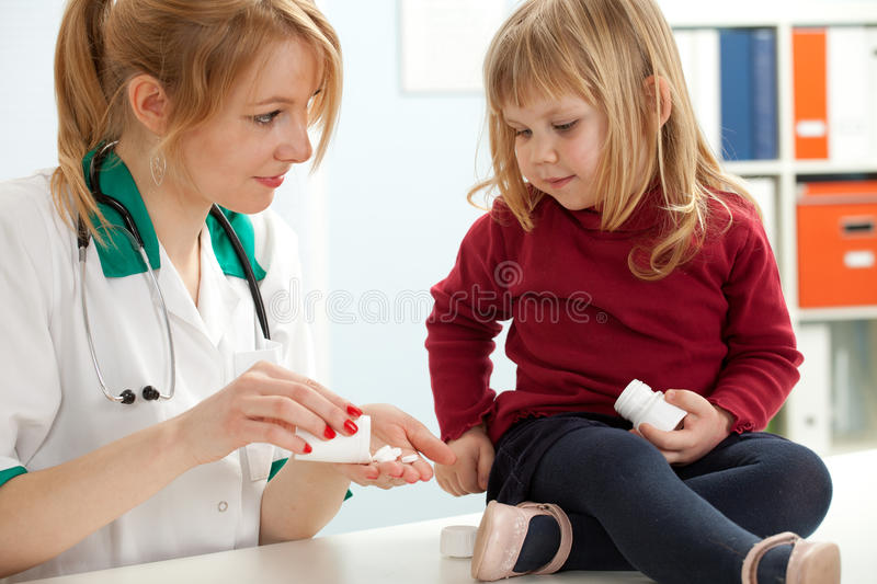 Download Lady Doctor With Little Girl In Exam Room Stock Image - Image: 16097137